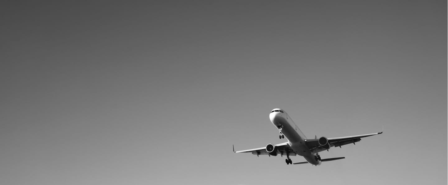 Airplane taking off in black-and-white